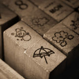 Sellos de goma de madera con los iconos del símbolo de la meteorología Imagen de archivo libre de regalías