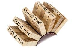 Sellos de goma el alfabético inglés, aislado en el backgr blanco Fotografía de archivo libre de regalías