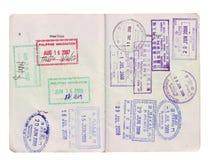 Sellos de visa del recorrido en pasaporte Foto de archivo libre de regalías