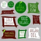 Sellos del vintage, aceite Aceite planchado en frío, eco 100 y prodect crudo orgánico, todo natural, puro Argan, yuzu, semilla ne Imagen de archivo libre de regalías