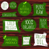 Sellos del vintage, aceite Aceite planchado en frío, eco 100 y prodect crudo orgánico, todo natural, puro Argan, yuzu, semilla ne Fotografía de archivo