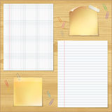 Sells and strips notebook paper with paper clips on wood table b Stock Image