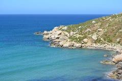 Selmun Bay (Imġiebaħ Bay). Calm Mediterranean Sea on Selmun Bay - Malta, nice clear day Royalty Free Stock Photography