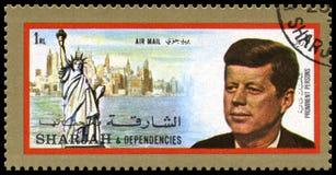 Selo de John F Kennedy Postage do vintage de Sharjah fotos de stock