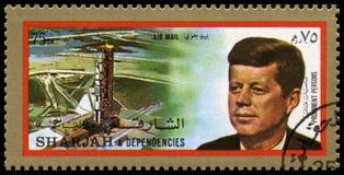 Selo de John F Kennedy Postage do vintage de Sharjah imagem de stock