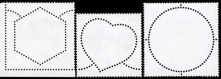 Selo de porte postal em branco quadro pela beira preta. fotografia de stock