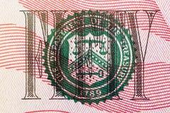 Selo do Departamento da Tesouraria no macro do close up da nota de dólar dos E.U. cinqüênta Fotos de Stock Royalty Free