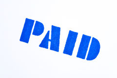 Selo pago azul no branco Fotos de Stock Royalty Free