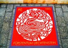 Selo postal com a imagem das serpentes Foto de Stock