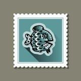 Selo postal com um peixe Imagens de Stock