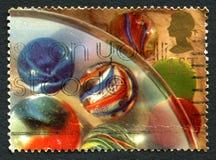 Selo postal do Reino Unido dos mármores fotos de stock