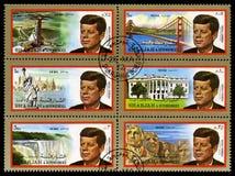 Selos de John F Kennedy Postage do vintage de Sharjah imagem de stock royalty free