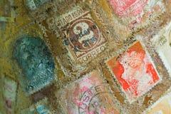 Selos de porte postal do mundo Fotos de Stock