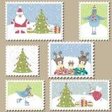 Selos de porte postal do Natal ilustração do vetor