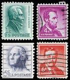 Selos de porte postal do vintage dos E.U. fotos de stock