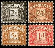 Selos devidos do porte postal britânico do vintage Fotografia de Stock