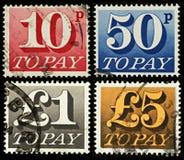 Selos devidos do porte postal de Grâ Bretanha Fotografia de Stock Royalty Free
