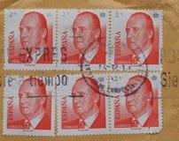 Selos do espanhol sobre o envelope marrom Fotografia de Stock