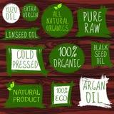 Selos do vintage, óleo Frio - óleo pressionado, eco 100 e prodect cru orgânico, toda natural, puro Argão, yuzu, semente preta e Fotografia de Stock