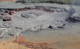Seltun / Krysuvik Krýsuvík: Boiling hot bubbling and steaming mud pot stock photography