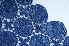Selvage of blue old fashioned lacy fabric. Selvage of pale blue old fashioned lacy fabric stock images
