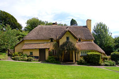 Selworthy thatched cottage. Thatched roof cottage on Selworthy green in Somerset Royalty Free Stock Image