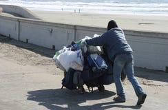 Sem abrigo na praia Imagens de Stock Royalty Free
