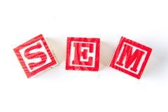 SEM Search Engine Marketing - bloques del bebé del alfabeto en blanco Imagen de archivo libre de regalías