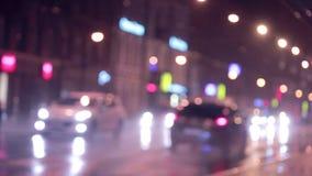 Semafori Defocused di notte Cenni storici urbani stock footage