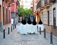 Semana santa en Sevilla, nazarenes, Andalucía, España Imágenes de archivo libres de regalías