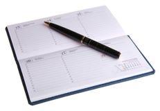 Semanario y pluma Imagen de archivo libre de regalías