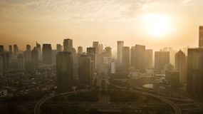 Semanggi road intersection under sunset. JAKARTA - Indonesia. May 21, 2018: Aerial view of Semanggi road intersection with skyscrapers at sunset time in Jakarta Royalty Free Stock Photos