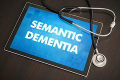 Semantic dementia (communication disorder) diagnosis medical con. Cept on tablet screen with stethoscope Stock Photo