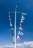 Semaphore flags on mast Royalty Free Stock Photos