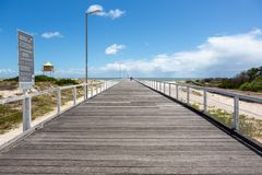 The Semaphore jetty with blue skies and fluffy clouds at Semaphore South Australia on 7th November 2018 royalty free stock photos