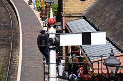 Semaphore signal at railway station. Royalty Free Stock Image