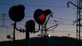 Semaphore or stoplight on railway station at dark sky stock footage