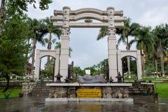 Semarang, Indonesia - December 3, 2017 : Main gate of Vihara Buddhagaya Watugong with a rock shaped like a gong in front of it. royalty free stock photography