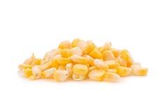 seme giallo del cereale su un fondo bianco fotografie stock libere da diritti