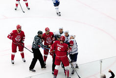 A. Semenov (5) and D. Znakharenko (73) fight. PODOLSK - OCTOBER 30, 2016: A. Semenov (5) and D. Znakharenko (73) fight on hockey game Vityaz vs Dynamo Minsk on stock images