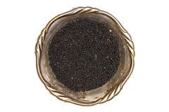 Sementes de cominhos pretas isoladas no branco fotos de stock