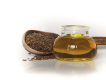 Sementes de linho e óleo de Flaxseed Fotografia de Stock Royalty Free