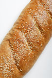 Sementes do sésamo no pão francês fotografia de stock royalty free
