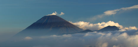 Semeru. Active Semeru volcanoe with some ash smoke frome it at twilight Stock Photo