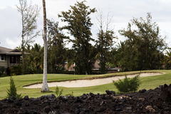 Semesterortgolfbanahål och sand Pit Kona Hawaii Royaltyfria Bilder