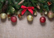 Semestra julleksaker på filialer av en julgran Royaltyfri Foto