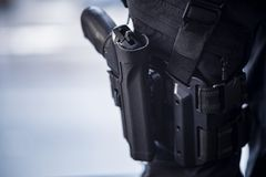 Pistol Holstered on Thigh on Security Personnel royalty free stock photos