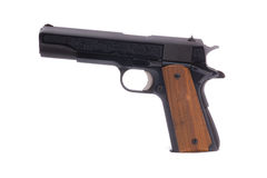 Semi-automatic Handgun. A photo of a modern semiautomatic handgun isolated on a white background. The weapon is engraved on the side. Similar weapons have been Stock Images