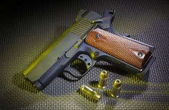 Semi automatic handgun with ammo Royalty Free Stock Photo