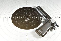 1911 semi automatic handgun and shooting target. Handgun and shooting target for practice Royalty Free Stock Photos